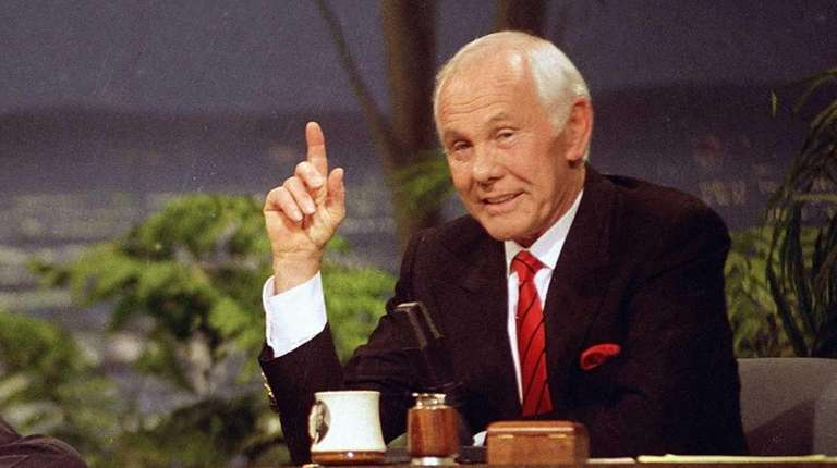 Talk show host Johnny Carson, right, is showm