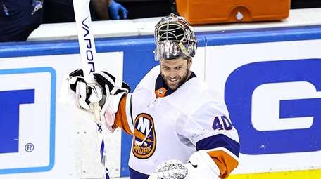 Semyon Varlamov #40 of the Islanders celebrates his