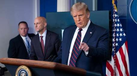 President Donald Trump speaks, accompanied by Food and