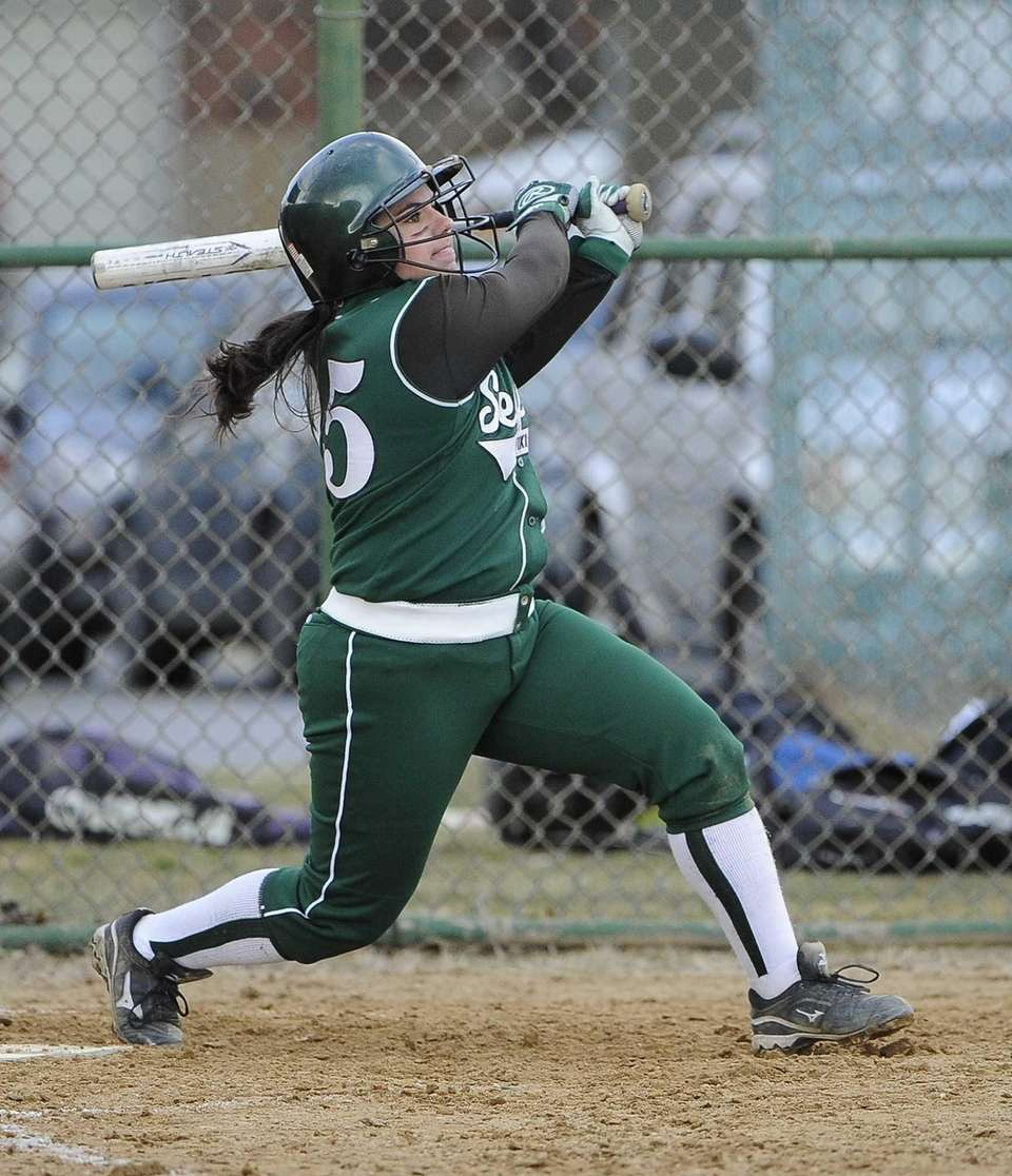 Seaford's Lindsay Montemarano follows through a home run