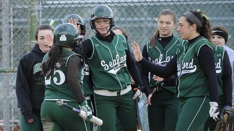 Seaford teammates congratulate Lindsay Montemarano on her second