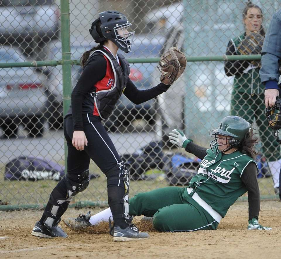 Seaford's Lindsay Montemarano slides home as Floral Park