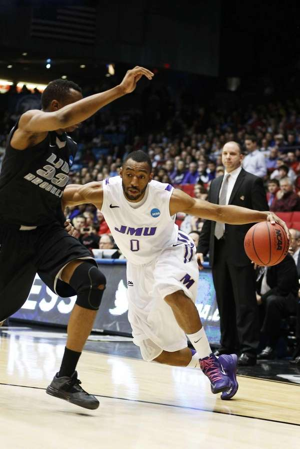 James Madison's A.J. Davis drives against LIU Brooklyn's