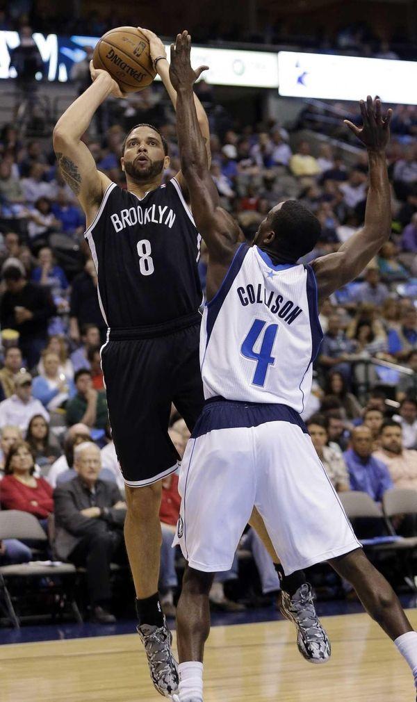 Nets guard Deron Williams shoots against Dallas Mavericks