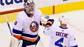 Islanders goaltender Semeyon Varlamov and defenseman Andy Greene