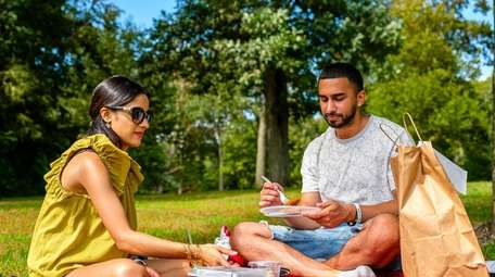 Melanie Gangapersaud and Andrew Singh have a picnic
