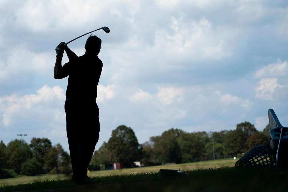 Golfers tee off on the Eisenhower Park Driving