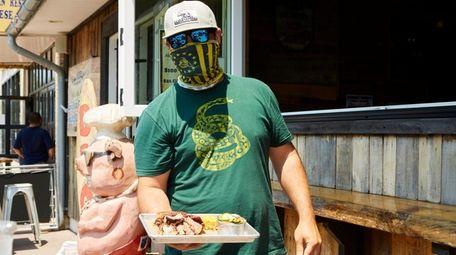 Owner Dan Monteforte serves brisket and ribs at