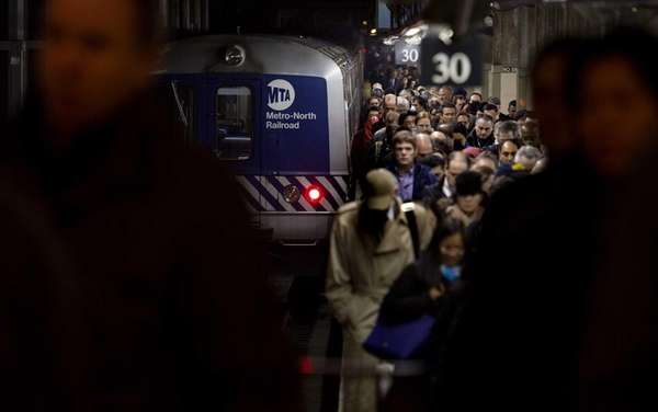 People disembark from a Metro-North train at Grand