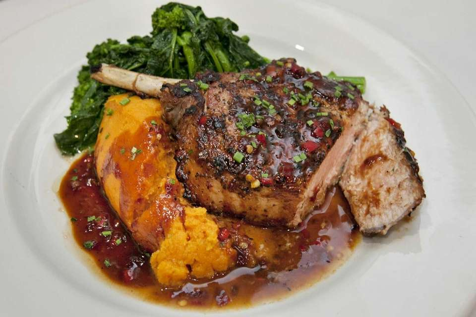 Heirloom Tavern's juicy Berkshire pork chop is finished