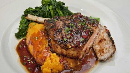 Heirloom Tavern's juicy Berkshire pork chop is finished