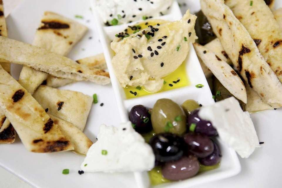An Heirloom Tavern appetizer of Mediterranean dips, olives
