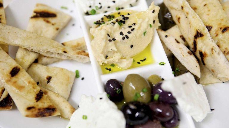 An Heirloom Tavern appetizer of Mediterranean dips, olives