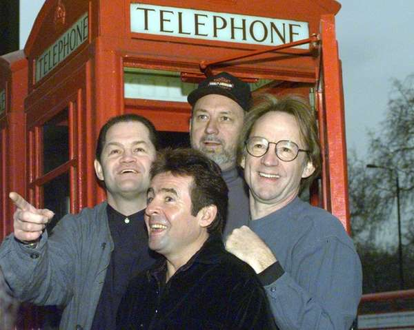 Members of the pop group The Monkees pose
