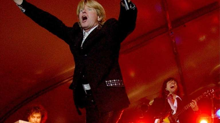 Peter Noone and the band Herman's Hermits perform