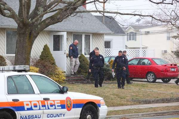 Nassau Police investigate the scene of a shooting