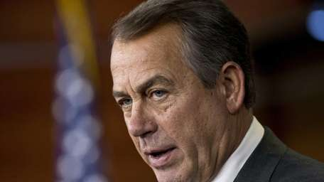 House Speaker John Boehner of Ohio answers a