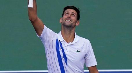 Novak Djokovic reacts to winning his match with