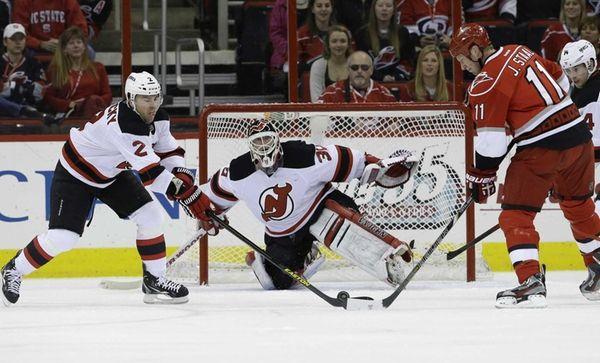 New Jersey Devils goalie Martin Brodeur and teammate