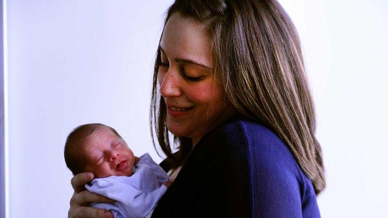 Kaylee Henriquez holds her newborn baby Mateo Bautista