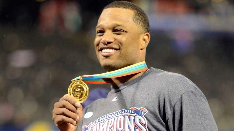 The Dominican Republic's Robinson Cano celebrates after defeating