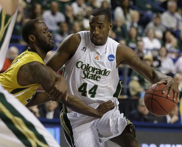 Colorado State forward Greg Smith drives against Missouri