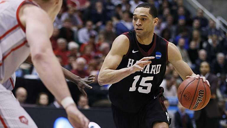 Harvard's Christian Webster drives the ball in the