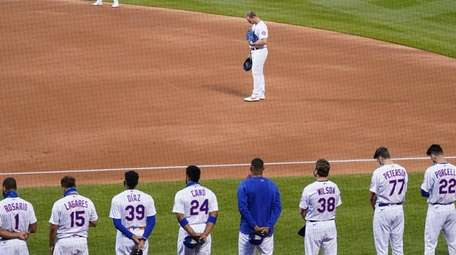 The Mets and Marlins stand on the field