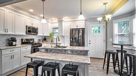 Listed for $399,000, this three-bedroom, one-bathroom Cape in