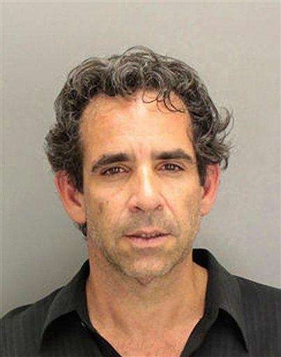 This undated booking photo provided by the Miami-Dade