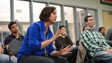 Instructor Valeri Lantz-Gefroh, left, offers direction to a