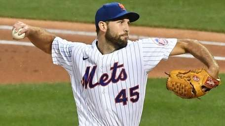 Mets starting pitcher Michael Wacha delivers against the