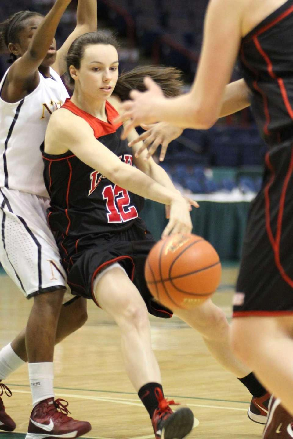 Long Island Lutheran's Katie Lavelle passes the ball