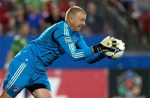 FC Dallas goalkeeper KevinHartman makes a save against