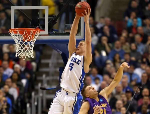 Duke's Mason Plumlee catches a pass for a