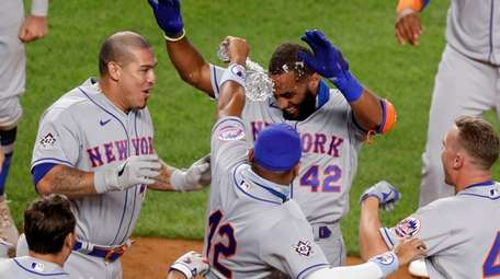 Amed Rosario of the Mets celebrates his seventh-inning
