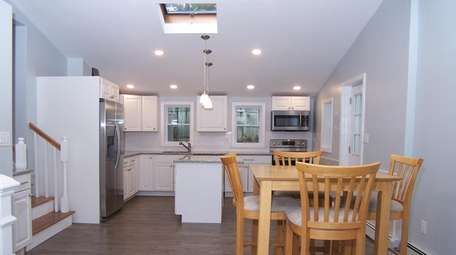 The home has an eat-in kitchen with stainless