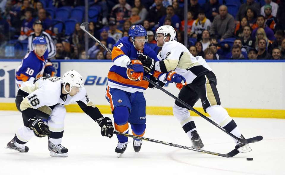 Mark Streit of the Islanders tries to skate
