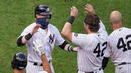 The Yankees' Clint Frazier celebrates with teammates after