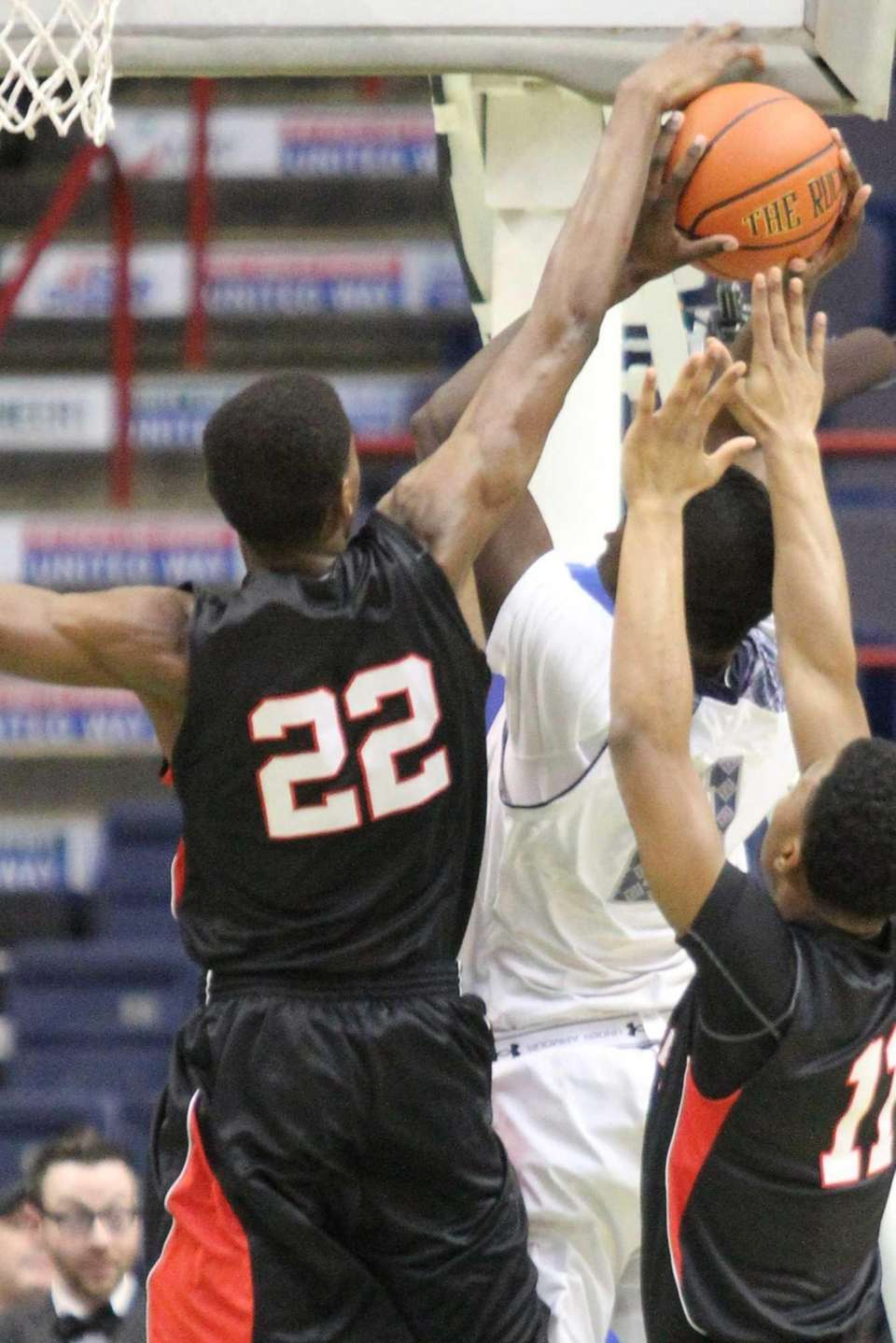 Long Island Lutheran's Kentan Facey blocks Tre'vonn Morton's