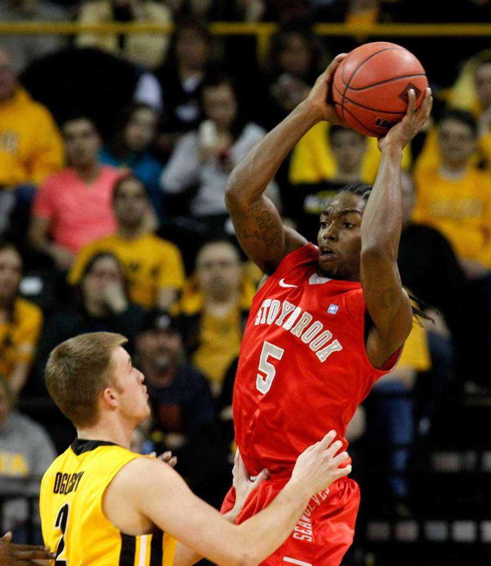 Stony Brook guard Dave Coley looks to pass