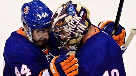 Islanders center Jean-Gabriel Pageau celebrates with goaltender Semyon
