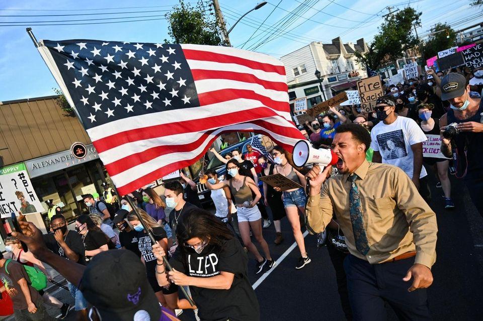 Terrel Tuosto, in tan, leads the march down