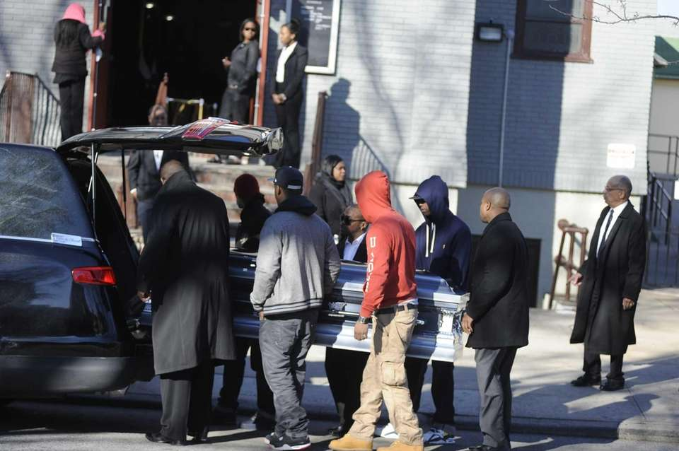 Pallbearers with the coffin of 16-year-old Kimani Gray,
