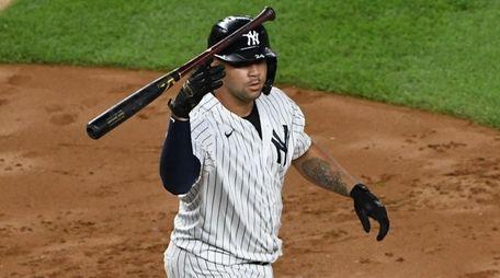 Yankees catcher Gary Sanchez tosses his bat on
