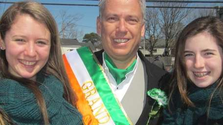 Grand marshal Steve Flotteron with his daughters Madison,