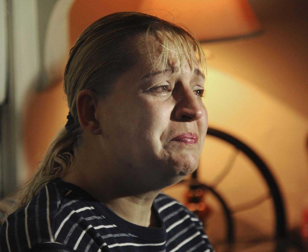 Sherry West breaks down in tears as she