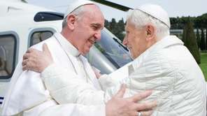 Pope Francis (left) and his predecessor, Pope Emeritus