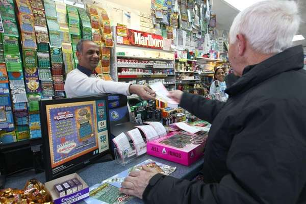 Frank Grasso, of Lindenhurst, buys his Powerball tickets