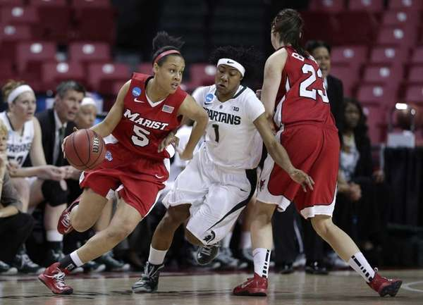 Marist guard Sydney Coffey, left, drives around Michigan